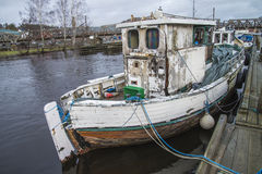 Old Fishing Boat Moored On The River Pier Royalty Free Stock Photography