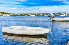 Old fishing boat moored at sea coast harbour on Majorca island. Spain Balearic islands, anchored boats at harbor of Portocolom, Mallorca Mediterranean Sea Stock Photo