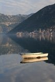Old fishing boat in the morning in Montenegro. Stock Photos