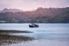 Old fishing boat near a coast ot tropical island Stock Images
