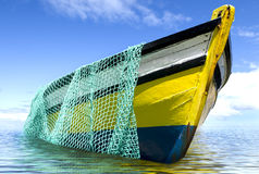 The old fishing boat. With fishing net Royalty Free Stock Photography