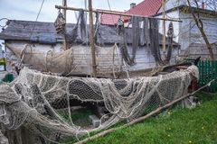 Old fishing boat. And nests in Jastarnia village on Hel Peninsula, Poland Royalty Free Stock Photo
