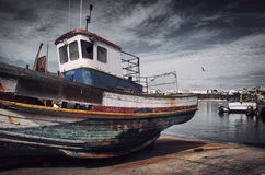 Old Fishing Boat. With peeling paint in a dry dock in Sines, Portugal Stock Photo