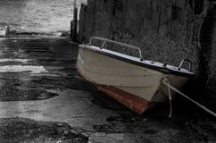 Old fishing boat on the pier royalty free stock image