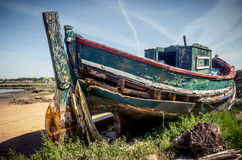 Old Fishing Boat. The remains of an old fishing boat rotting on the river shore Royalty Free Stock Photos