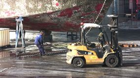 Old fishing boat reoairing in dry dock. stock footage