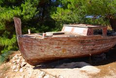 Old fishing boat on a rocky shore, Croatia Royalty Free Stock Image