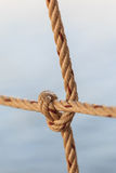 Old fishing boat rope with a Tied Knot Stock Images