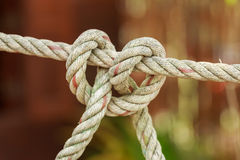 Old fishing boat rope with a Tied Knot Royalty Free Stock Photos
