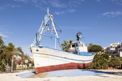 Old fishing boat in a roundabout in Spain Royalty Free Stock Image