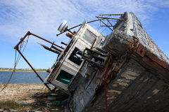 Old Fishing Boat on it's Side Royalty Free Stock Image