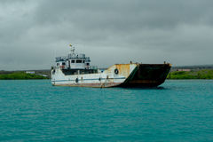 Old Fishing Boat sailing in a beautiful magenta waters in Galapagos in a cloudy day Stock Photography