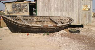 Old fishing boat. On a sandy beach of the Azov Sea royalty free stock photo