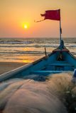 Old fishing boat on the sandy shore Royalty Free Stock Image