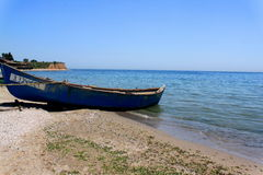 Old fishing boat on the seashore Stock Photography