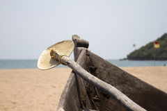 Old fishing boat standing on the sandy beach. India, Goa Royalty Free Stock Image