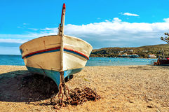 Old fishing boat stranded on the beach in Cadaques, Costa Brava, Royalty Free Stock Photos