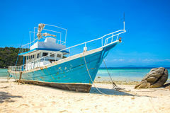 Old fishing boat stranded on a beach Royalty Free Stock Photo