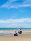 Old fishing boat stranded on a beach in sunny day, Thailand Royalty Free Stock Photography