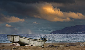 Old fishing boat at sunset Stock Photo