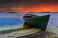 Old fishing boat at sunset Royalty Free Stock Image