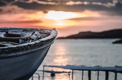 Old fishing boat on sunset, paint is coming out royalty free stock photos