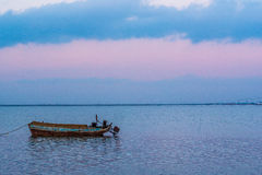 Old fishing boat at sunset time Stock Photography