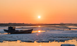 Old fishing boat at sunset time Stock Photo