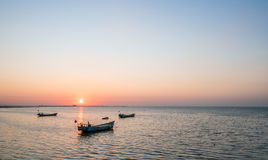 Old fishing boat at sunset time Royalty Free Stock Images