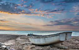 Old fishing boat at sunset. View on old fishing boat and the Red sea at sunset, Eilat, Israel stock images