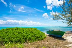 Old fishing boat on a tropical beach at the Royalty Free Stock Photo