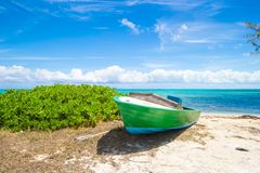 Old fishing boat on a tropical beach at the Royalty Free Stock Image