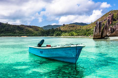 Old fishing boat on Tropical beach at Curieuse island Seychelles. Horizontal shot Royalty Free Stock Photography