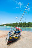 Old fishing boat on Tropical beach at Seychelles Stock Images
