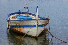 Old fishing boat. Of white and blue color Royalty Free Stock Photos