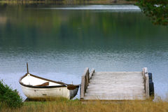 Old fishing boat. On a wooden pier Royalty Free Stock Images