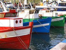 Old fishing boats. Colorful fishing boats on the dock Stock Photo