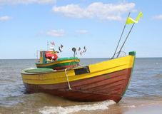 Old fishing boats  against beautiful sky #2 Royalty Free Stock Photography