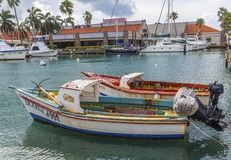 Old Fishing Boats in Aruba. ORENJASTAD, ARUBA - November 19, 2016: Being south of the hurricane belt and because of the constant breeze, temperatures and little stock photography
