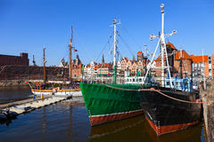 Old fishing boats. On the background panorama of Gdansk, Poland Stock Images