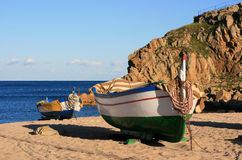 Old fishing boats on the beach. Old colorful fishing boats moored on the beach (Blanes - Costa Brava, Spain Royalty Free Stock Image
