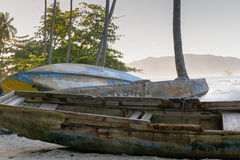 Old fishing boats. On the beach in a hazy storm in the Dominican Republic Stock Photo