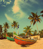 Old fishing boats on beach - vintage retro style Royalty Free Stock Photo