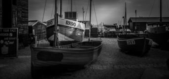Old fishing boats in black and white stock image