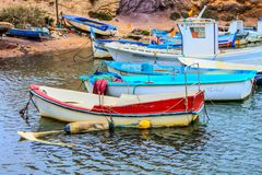 Old fishing boats. Of different colors and striking colors Stock Photography