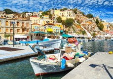 Old fishing boats docked in the gulf of Symi island in Greece Royalty Free Stock Photography