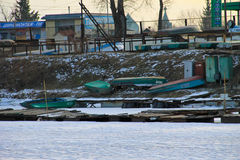 Old fishing boats in harbor on the frozen river Dnieper Stock Photos