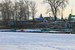 Old fishing boats in harbor on the frozen river Dnieper Stock Images