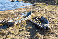 Old fishing boats on lake coast Royalty Free Stock Photos