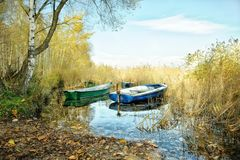 Old fishing boats. On a lake`s shore Stock Images